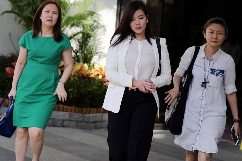 Rui En (centre) who was charged in court on June 22.ST PHOTO: WONG KWAI CHOW