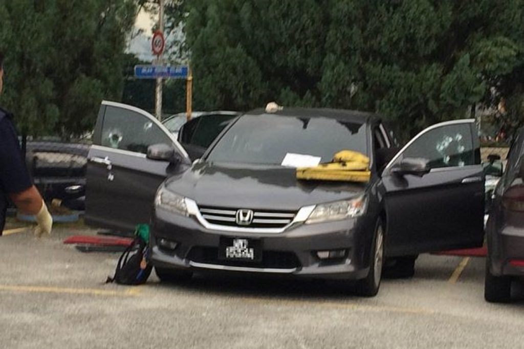 The shooter on the right of the car fired about three to four shots while the other fired 12. PHOTO: THE STAR/ASIA NEWS NETWORK